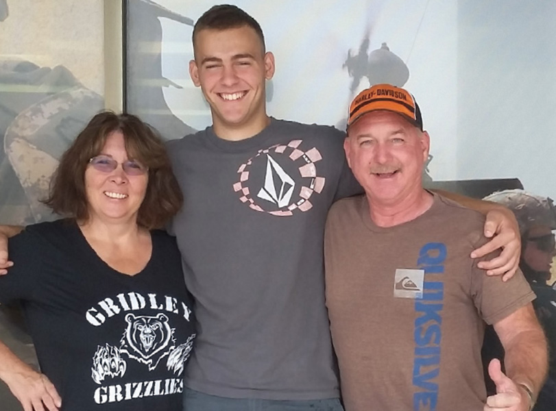 two adoptive parents with a teenage boy