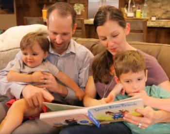 family on the couch reading