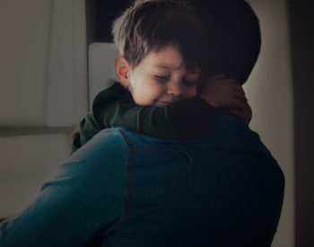boy hugging dad